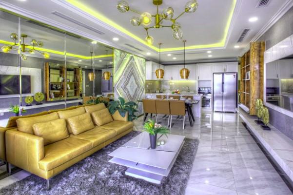 Ý tưởng nội thất phòng khách liền bếp tạo nên sự xuyên suốt không gian, giúp căn hộ trở nên thoáng đãng hơn